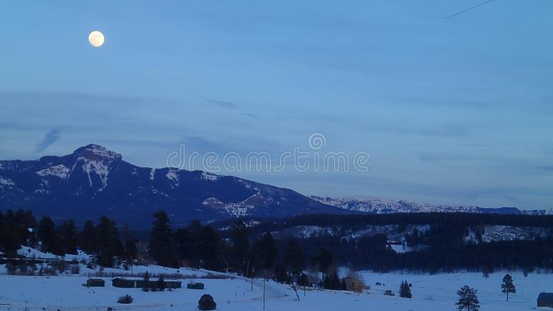 Full Moon Over the Mountains in Winter royalty free stock image