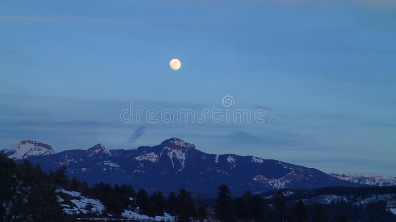 Full Moon Over the Mountains in Winter royalty free stock images