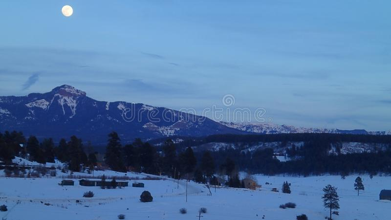 Full Moon Over the Mountains in Winter stock images