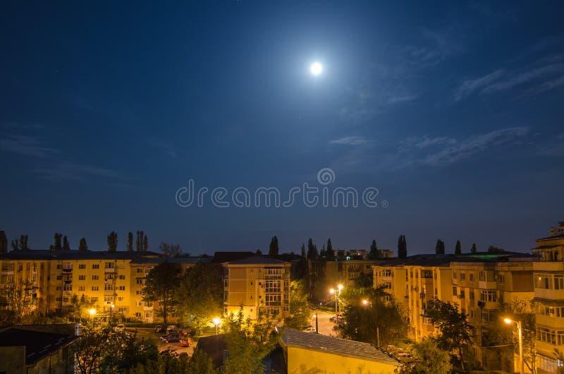 Full Moon over the neighbourhood stock photography