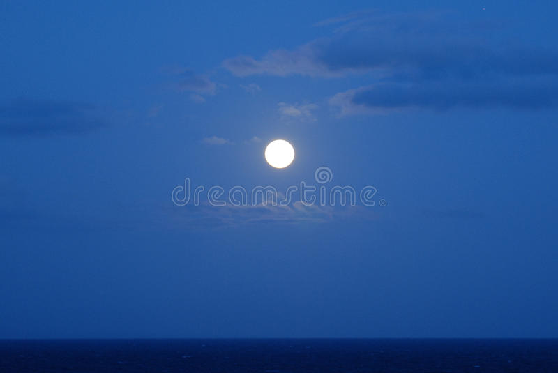 Download Full Moon over the Ocean stock image. Image of lunar, clouds - 9548863