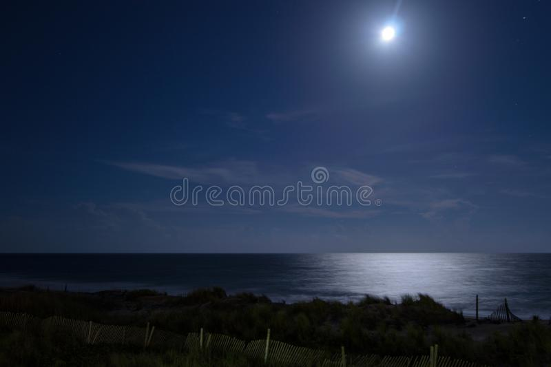 Full Moon Over Ocean on Clear Night stock images