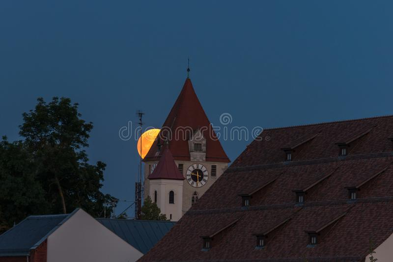 Full moon over the roofs and towers of Regensburg, Germany.  royalty free stock photos