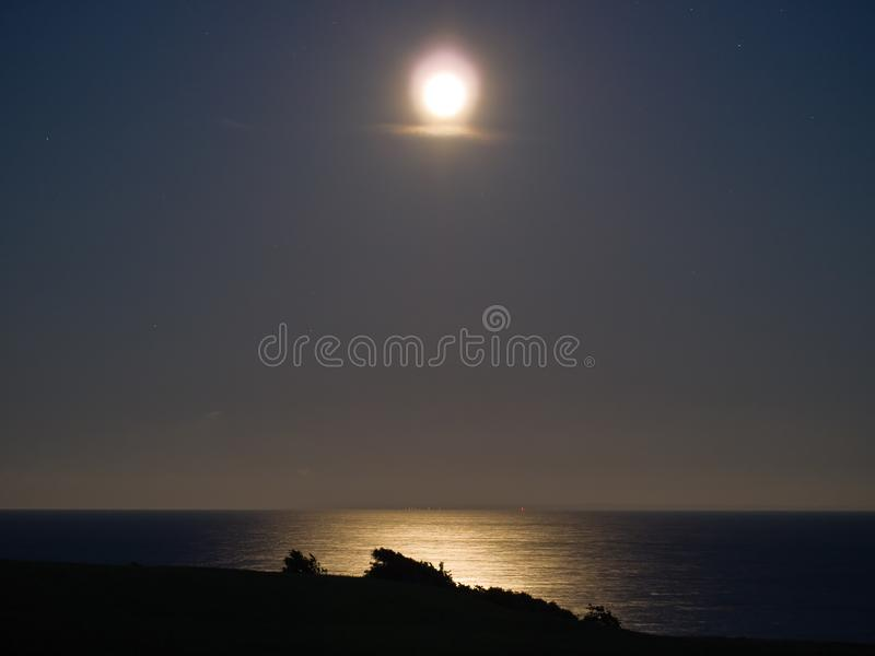 Full moon over the sea stock photo