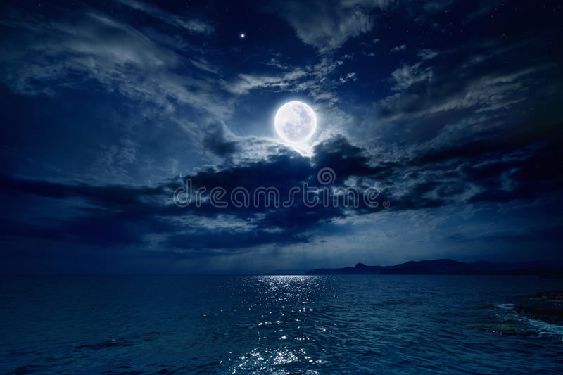 Full moon over sea stock image