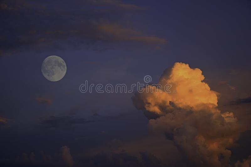 Colorful cloudscape with moon stock photography