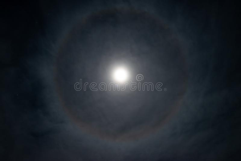 Full moon with ring shaped halo stock images