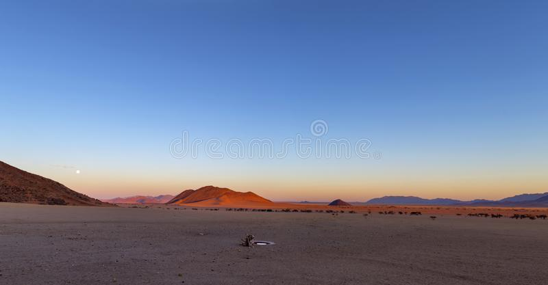 The full moon rise at sunset. Namibia stock images