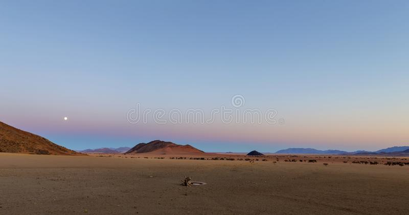 Full moon rise at sunset. Namibia royalty free stock photos