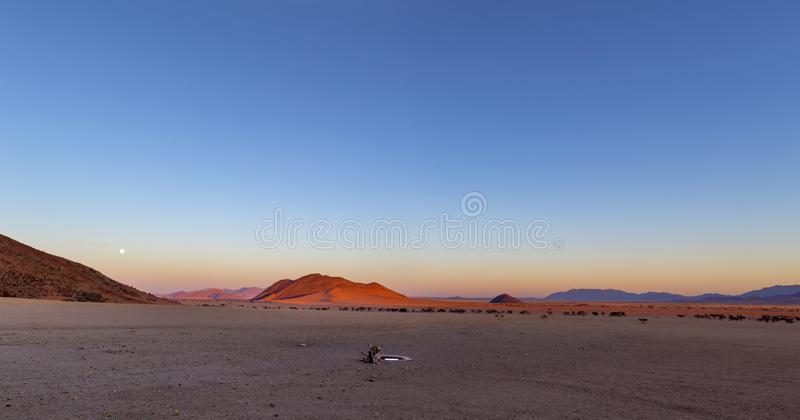 Full moon rise at sunset. Namibia royalty free stock image