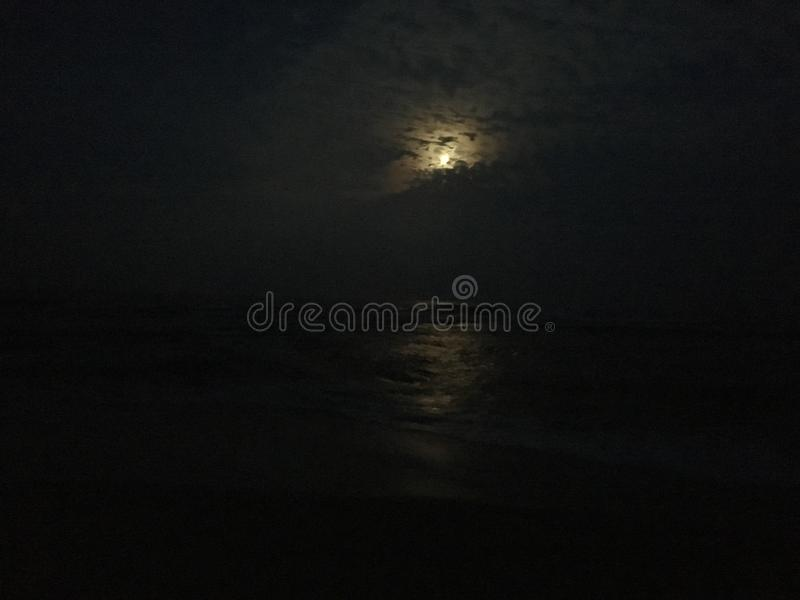 Full Moon Rising above Pacific Ocean on Kauai Island, Hawaii. stock images