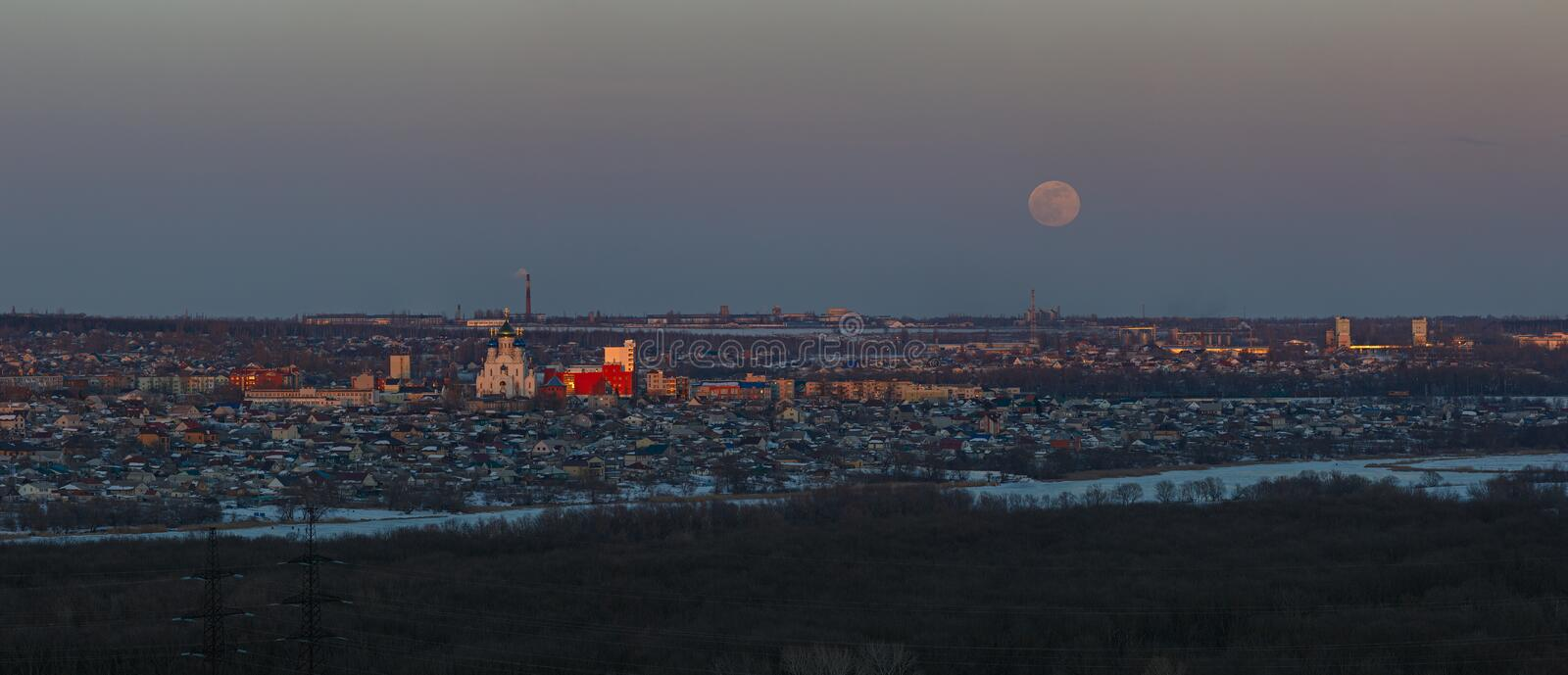 Full moon rising over the city. Sunset time in the twilight sky. Panoramic view of the Orthodox Church.  stock images