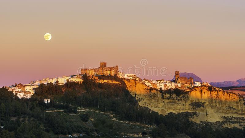 Arcos de la Frontera Full Moon Rise Cadiz Spain. Full moon rising over the town of Arcos de la Frontera in Cadiz sierra, Spain stock image