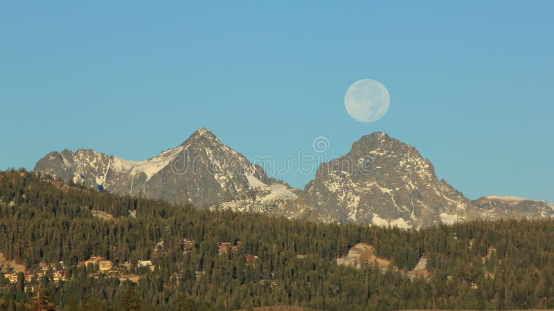 Full Moon Ritter & Banner Peaks. Mountains in the Ritter Range Sierra Nevada California. Ansel Adams Wilderness. Yosemite. Mammoth Lakes. Full Moon. Mt. Ritter stock images