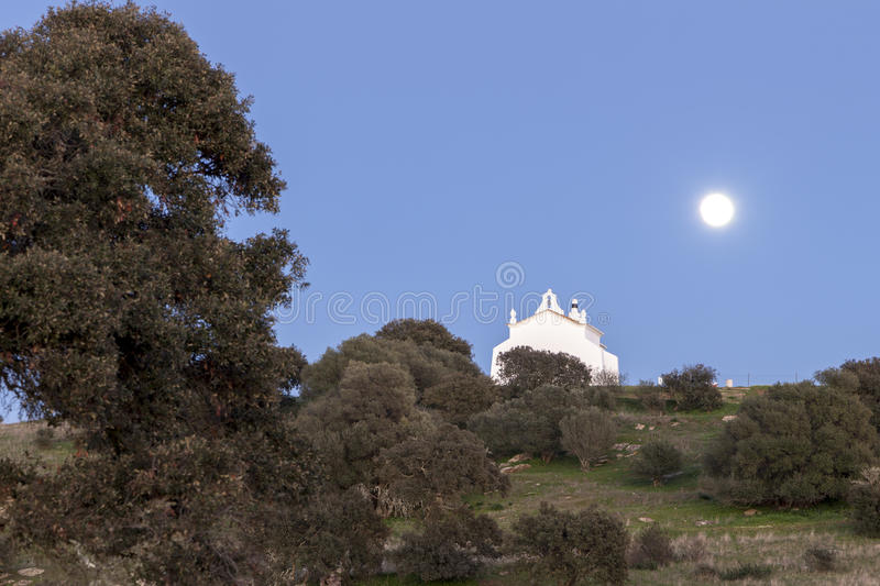 Full moon in a rural landscape of Castro, Verde, in the Alentejo, Portugal. Captured close to the historical place of Sao Pedro das Cabecas, where the King stock images
