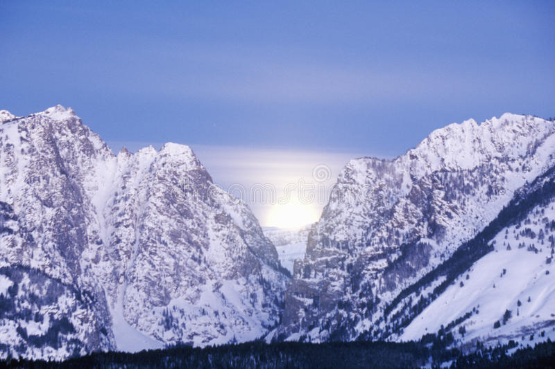 Download Full Moon Setting Behind The Grand Tetons, Stock Image - Image: 26263631