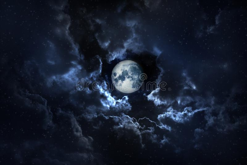 Full moon shining on the sky in cloudy day. royalty free stock photo