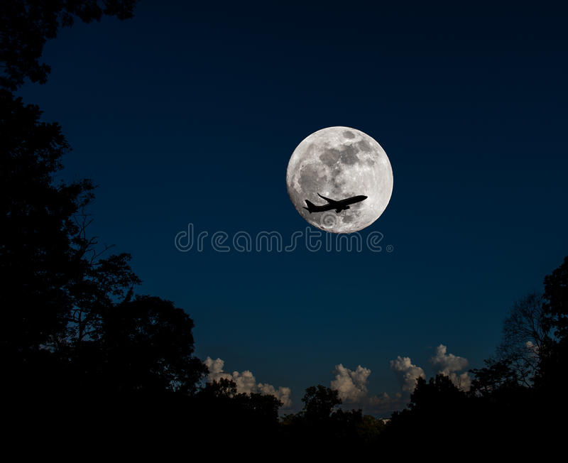 full moon and silhouette plane . royalty free stock photography
