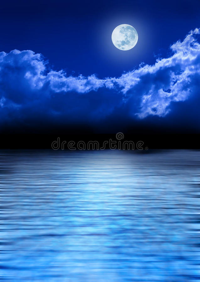 Full Moon Sky And Ocean. A full moon glowing in a night sky with a shimmering blue ocean below