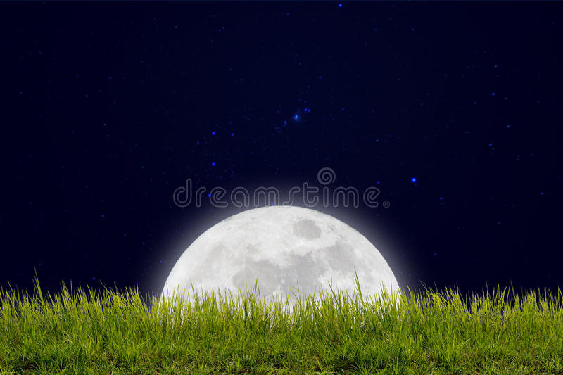 Full moon with stars and field of green hill on darkness sky. Moon with stars and field of green hill on darkness sky stock images