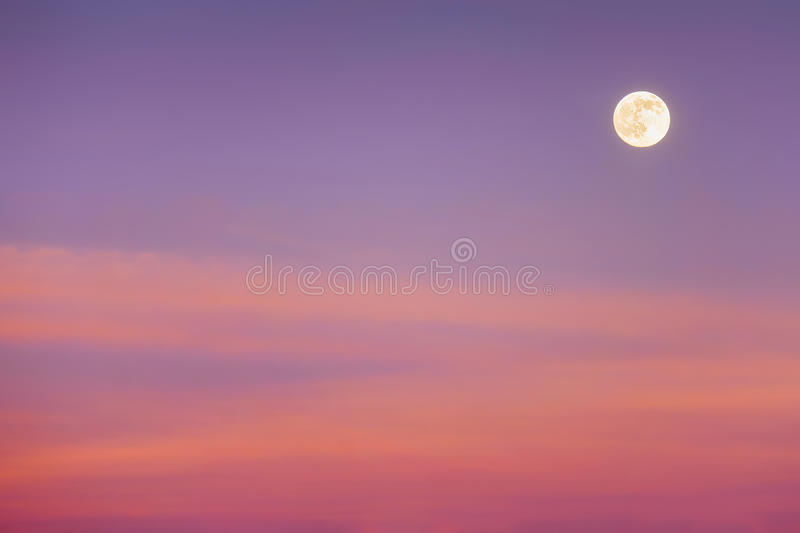 Full moon with sunset clouds. Full moon with red sunset clouds royalty free stock image