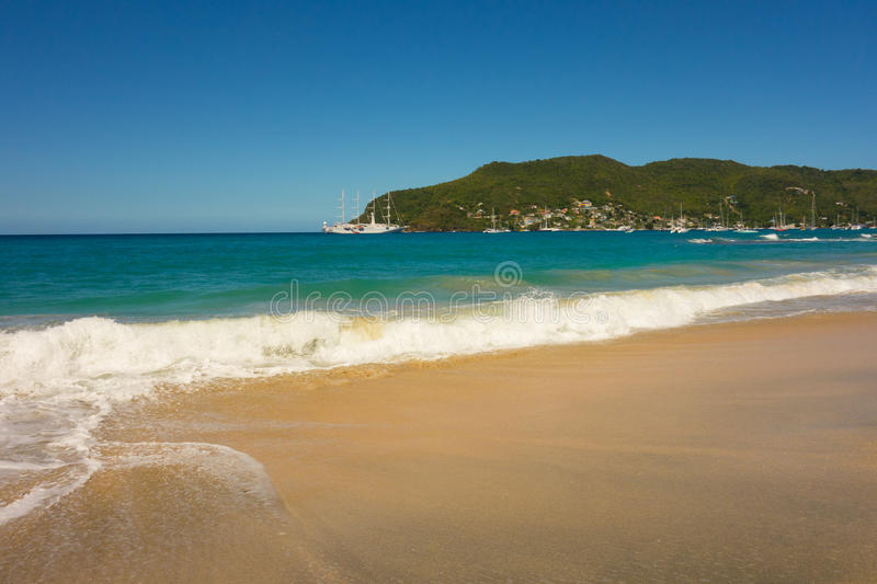 A full moon surge in the caribbean. Waves crashing onto a beach in the windward islands royalty free stock photography