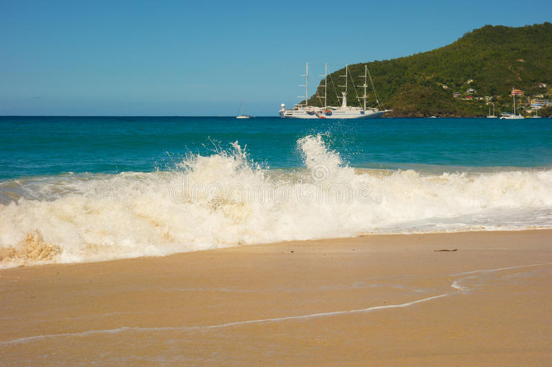 A full moon surge in the caribbean. Waves crashing onto a beach in the windward islands stock photography