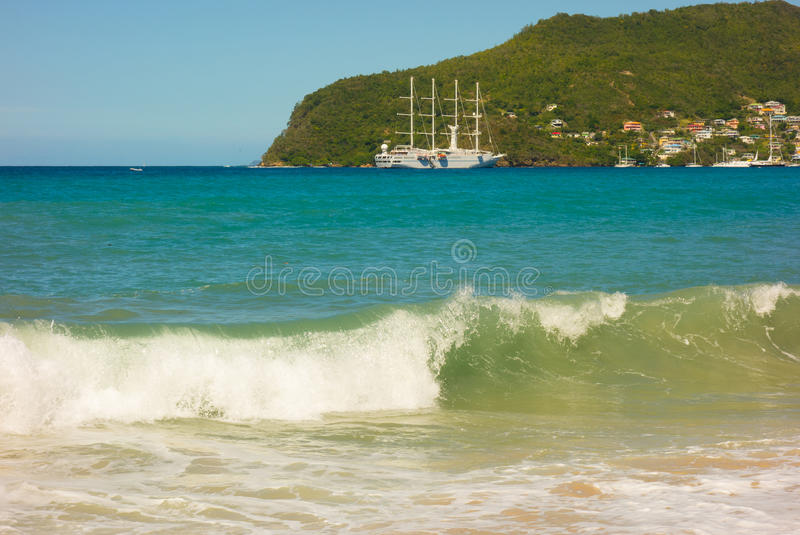A full moon surge in the caribbean. Waves crashing onto a beach in the windward islands royalty free stock photo