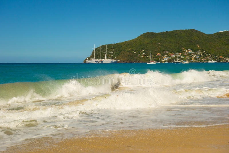 A full moon surge in the caribbean. Waves crashing onto a beach in the windward islands royalty free stock image