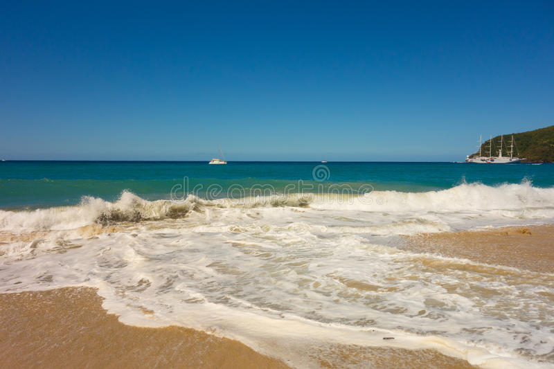 A full moon surge in the caribbean. Waves crashing onto a beach in the windward islands royalty free stock images