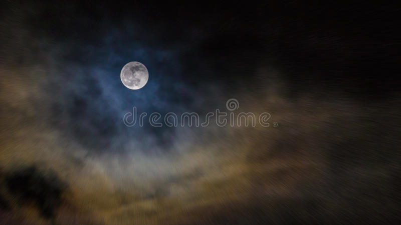 Full Moon. Surrounded by clouds royalty free stock photography