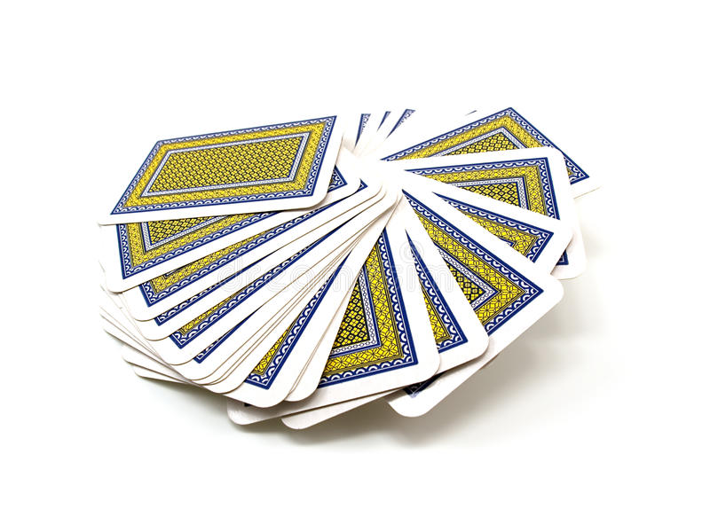 Full pack of playing cards. With a dark blue and yellow shirt isolated on a white background stock images