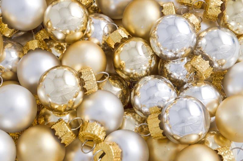 Full pack of reflecting christmas balls. Full pack of silver and golden christmas balls royalty free stock photography