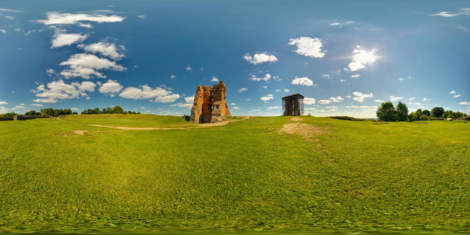 Full 360 panorama in equirectangular equidistant spherical projection of destroyed the ancient medieval castle on a sunny summer. Day, skybox for VR content royalty free stock image