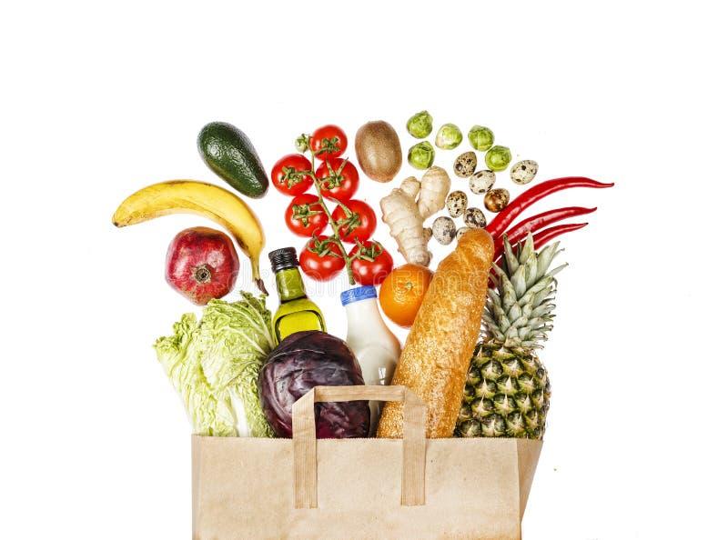 Full pappers- påse, köp, mat, uppsättning, konsument, lekmanna- lägenhet arkivfoto