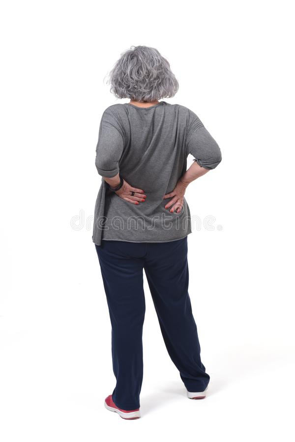 Full portrait of the back of an older woman with pain in the back on white background royalty free stock photos