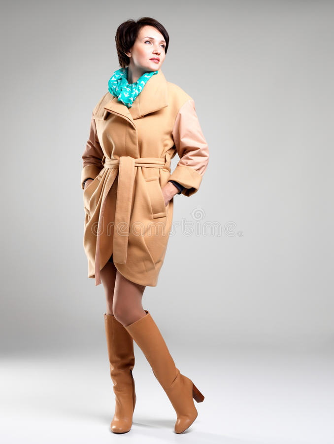 Full Portrait Of Fashion Woman In Autumn Coat With Green Scarf Royalty Free Stock Image