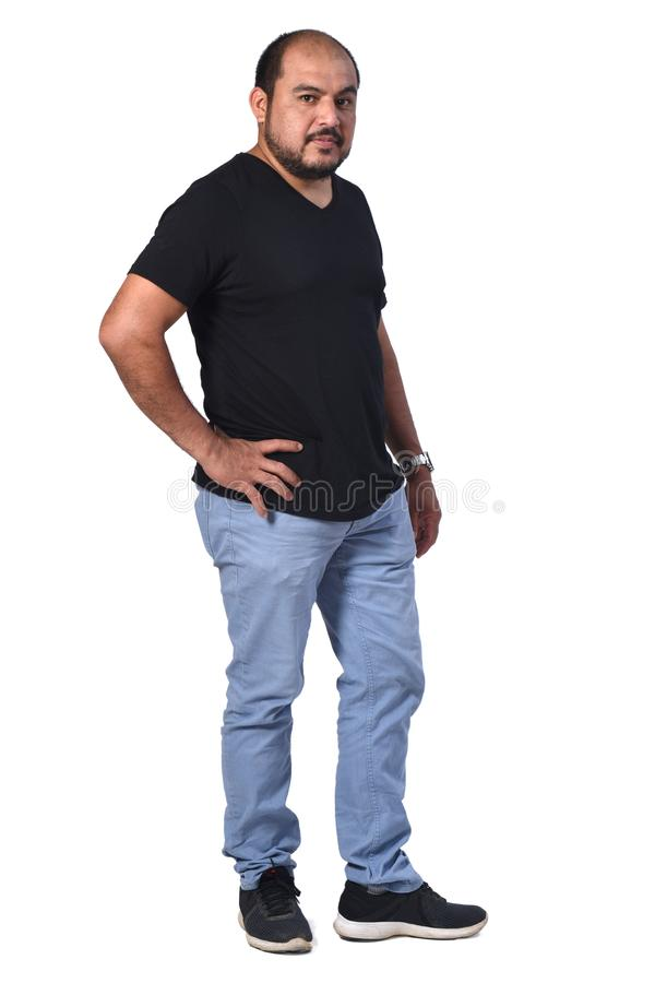 Full portrait of a latin man with hands on waist on white background stock photography