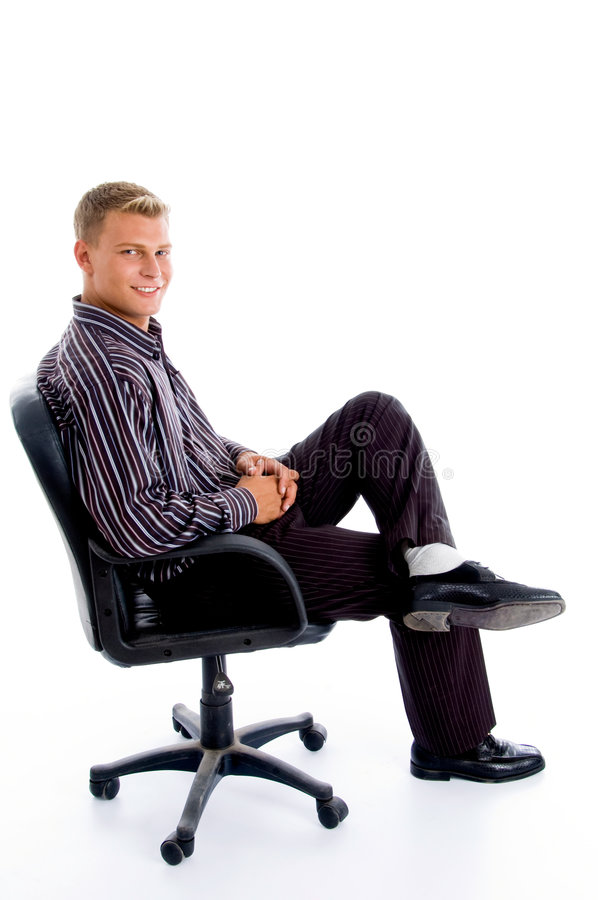 Full pose of stylish successful person. Sitting on the chair against white background royalty free stock photography