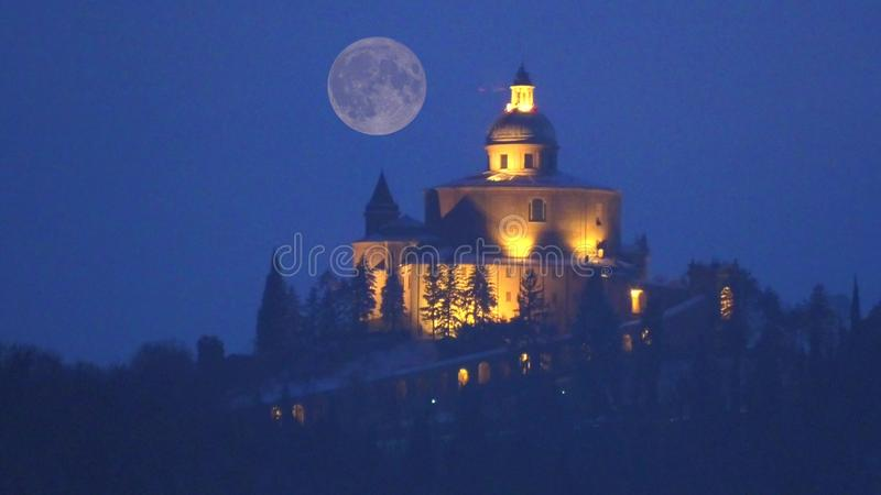 San Luca Church with red moon stock image