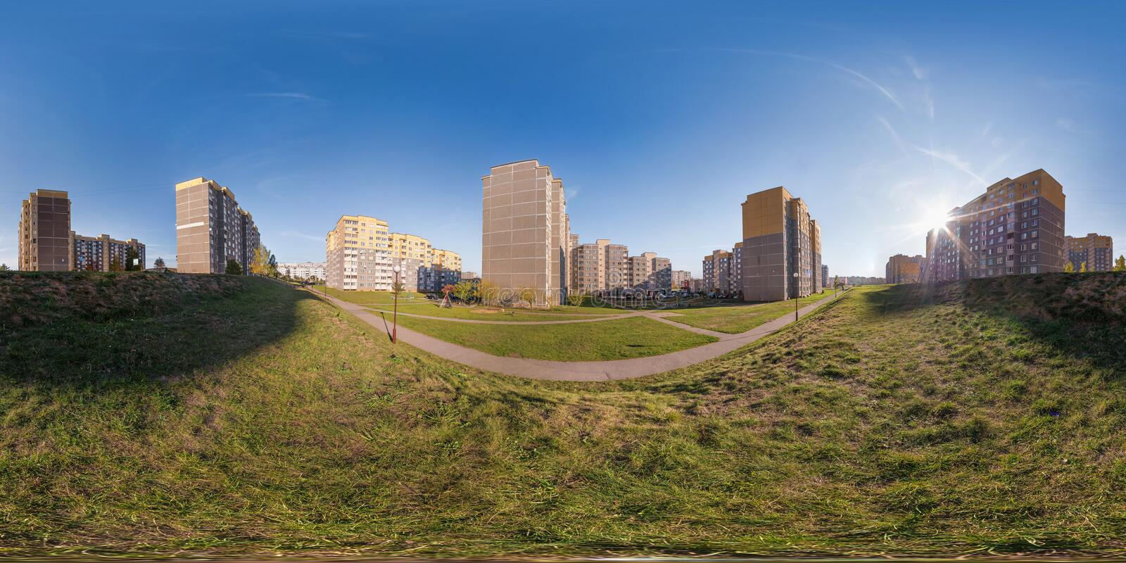 Full seamless 360 degrees angle view panorama high-rise building area urban development residential quarter in the evening in. Equirectangular spherical stock images