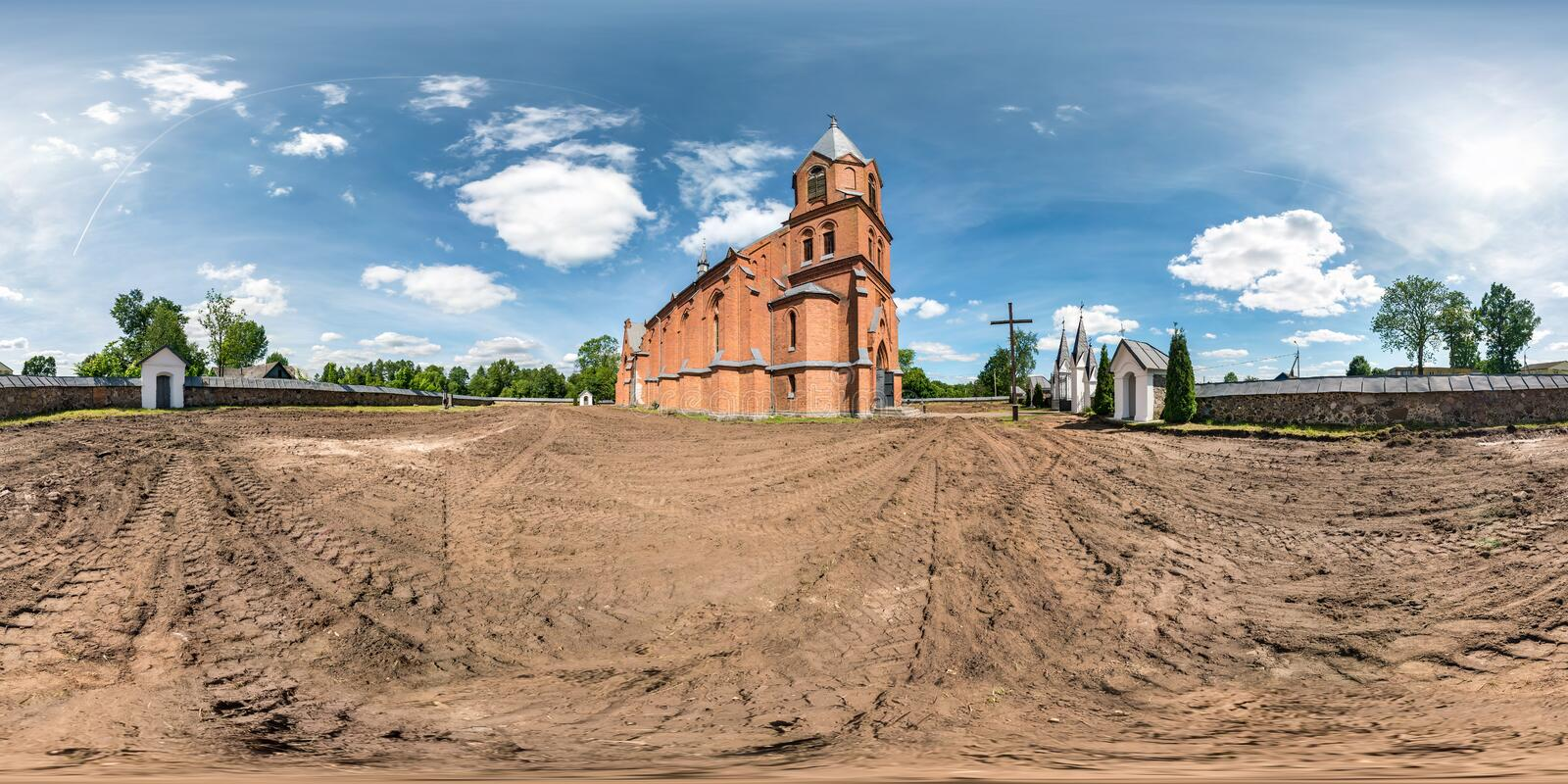 Full seamless hdri panorama 360 degrees angle view red brick facade of church in decorative medieval neo gothic style architecture stock photo