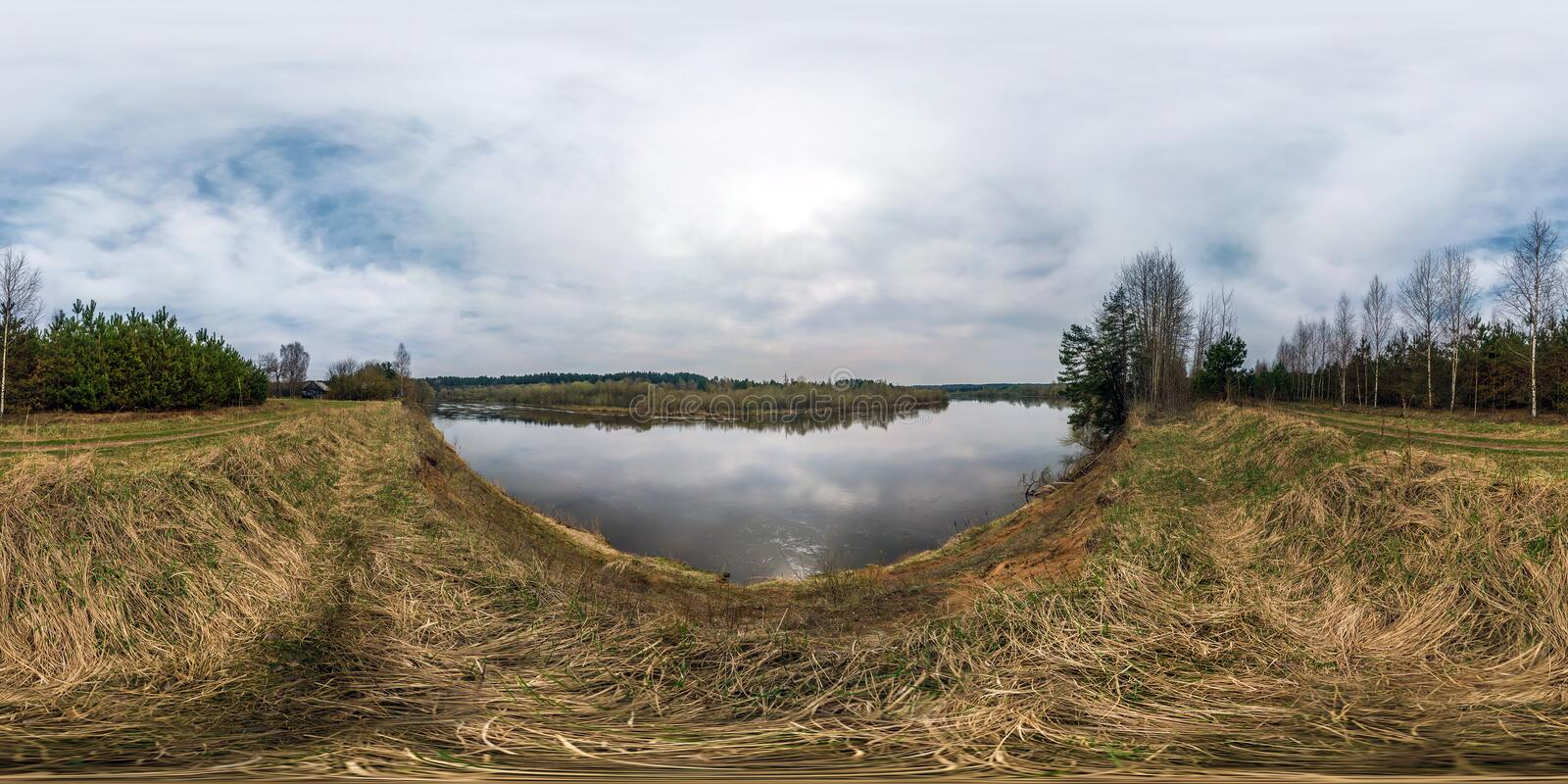Full seamless panorama 360 angle view at the high cliff of the broad river bank in sunny day. Skybox as background in royalty free stock photos