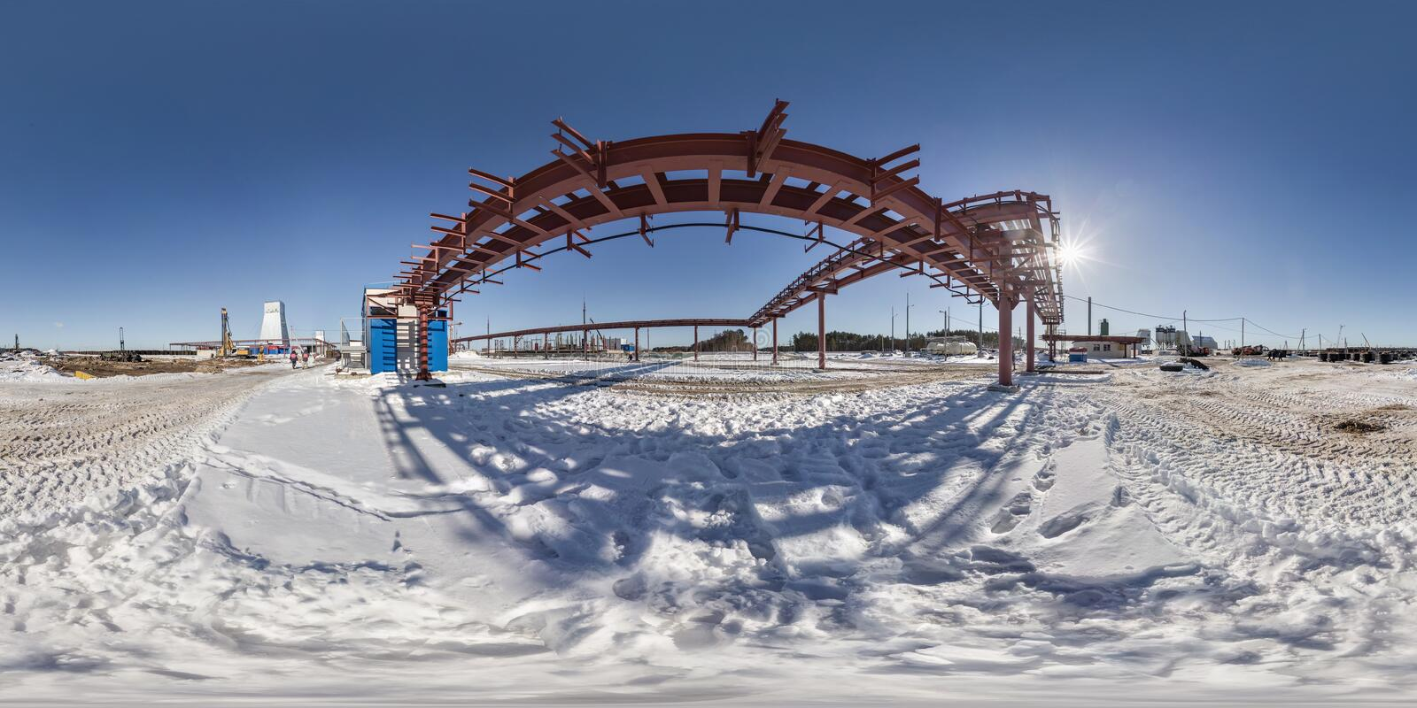 Full seamless panorama 360 angle view in winter snow field place site construction of a mining plant in equirectangular. Equidistant spherical projection, VR stock photos