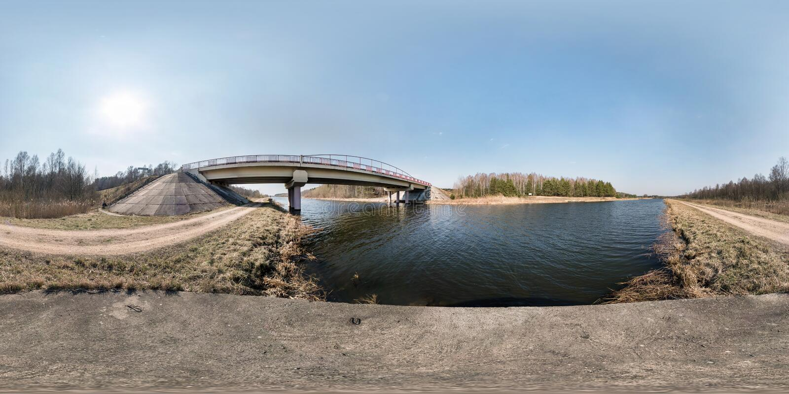 Full seamless spherical hdri panorama 360 degrees angle view bridge on the river in sunny day. background in equirectangular royalty free stock images