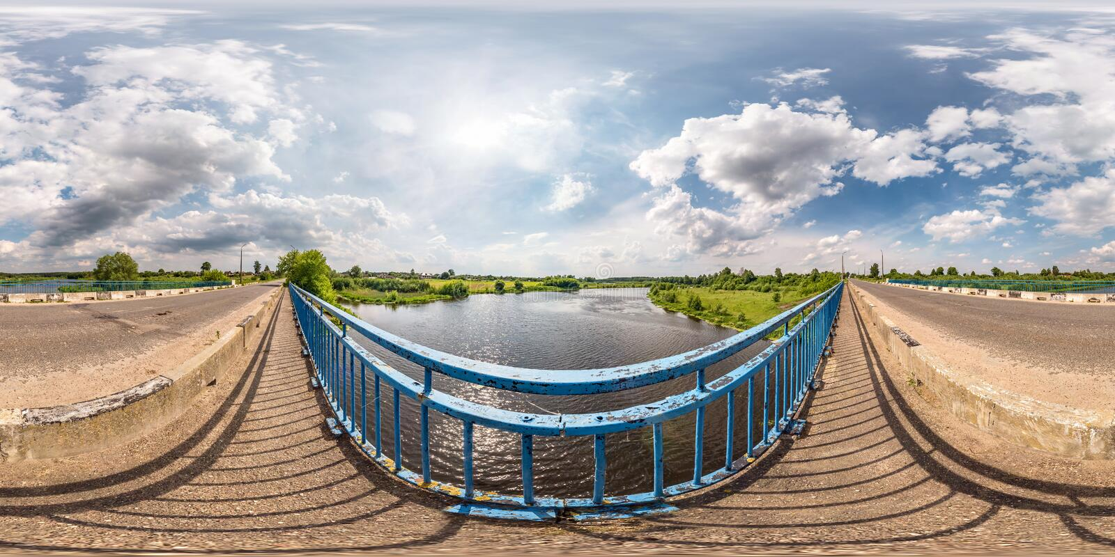 Full seamless spherical hdri panorama 360 degrees  angle view on concrete bridge near asphalt road across river in sunny summer. Day in equirectangular stock photos