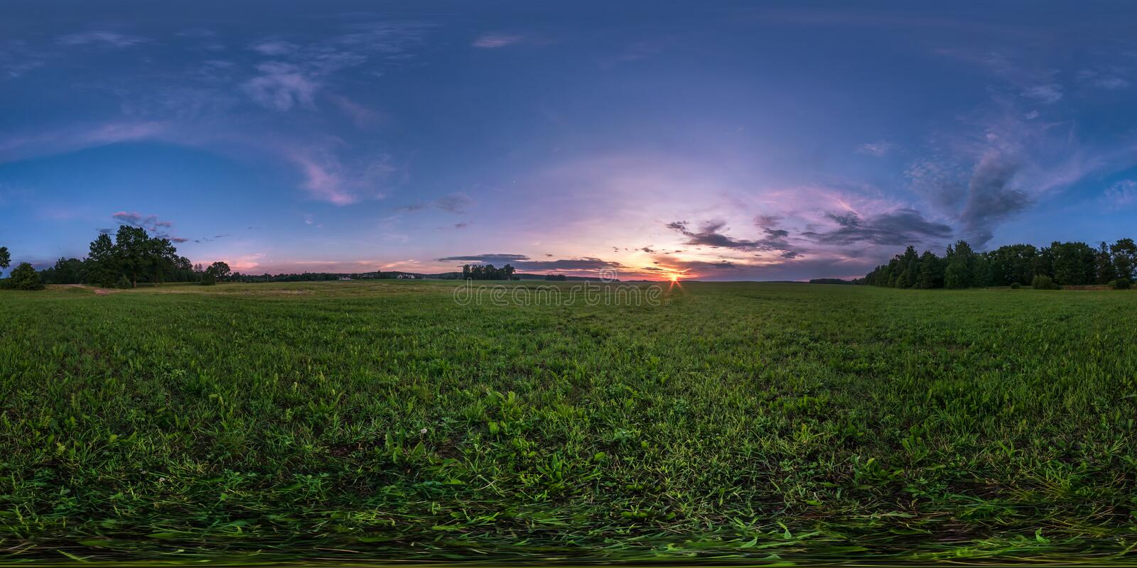 Full seamless spherical hdri panorama 360 degrees angle view among fields in summer evening sunset with awesome clouds in. Equirectangular projection, ready VR stock photos