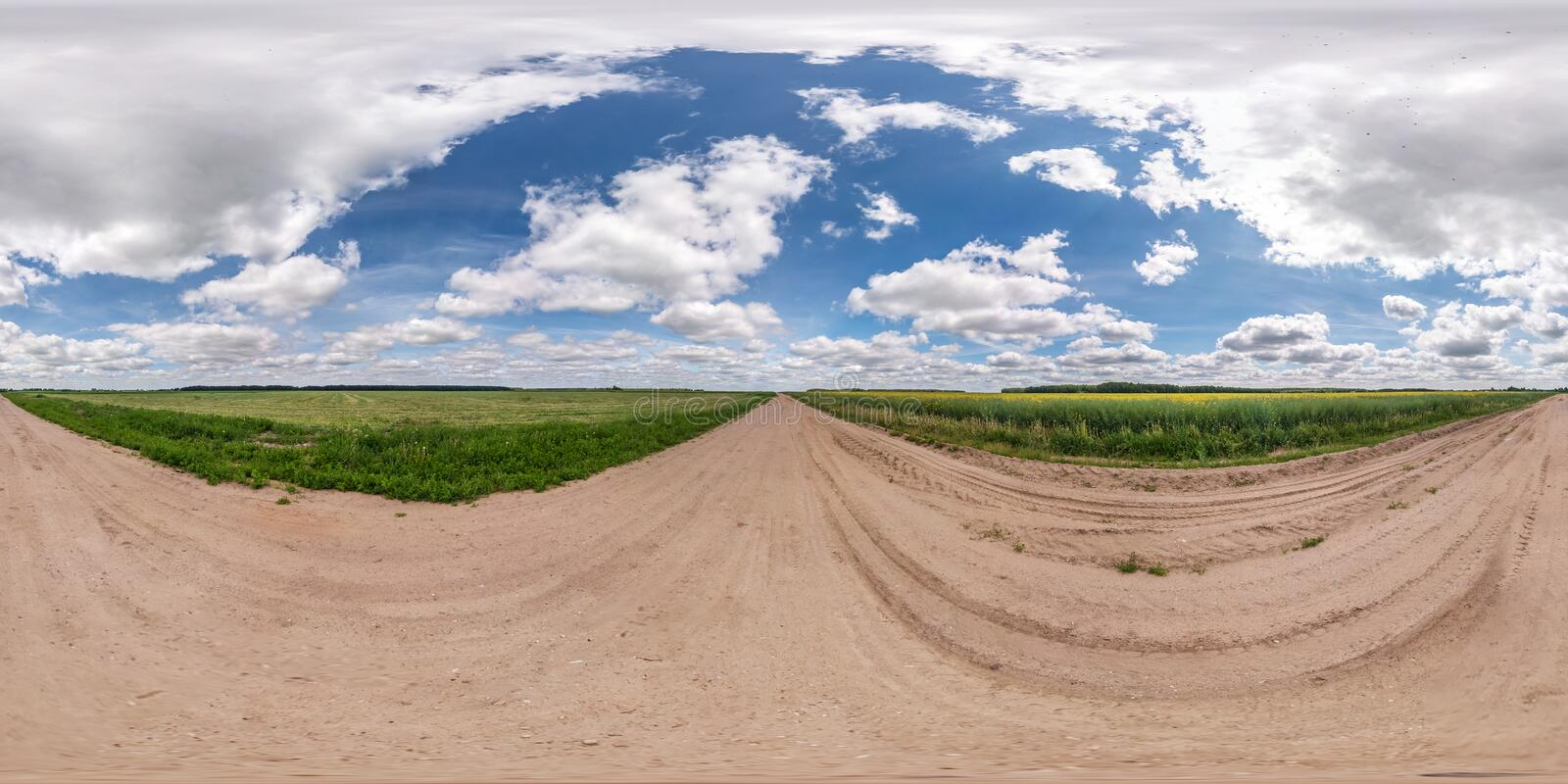 Full seamless spherical hdri panorama 360 degrees angle view on gravel road among fields in summer day with awesome clouds in. Equirectangular projection, for stock images
