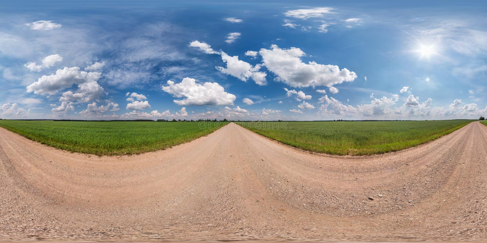 Full seamless spherical hdri panorama 360 degrees angle view on gravel road among fields in summer day with awesome clouds before. Storm in equirectangular stock photos