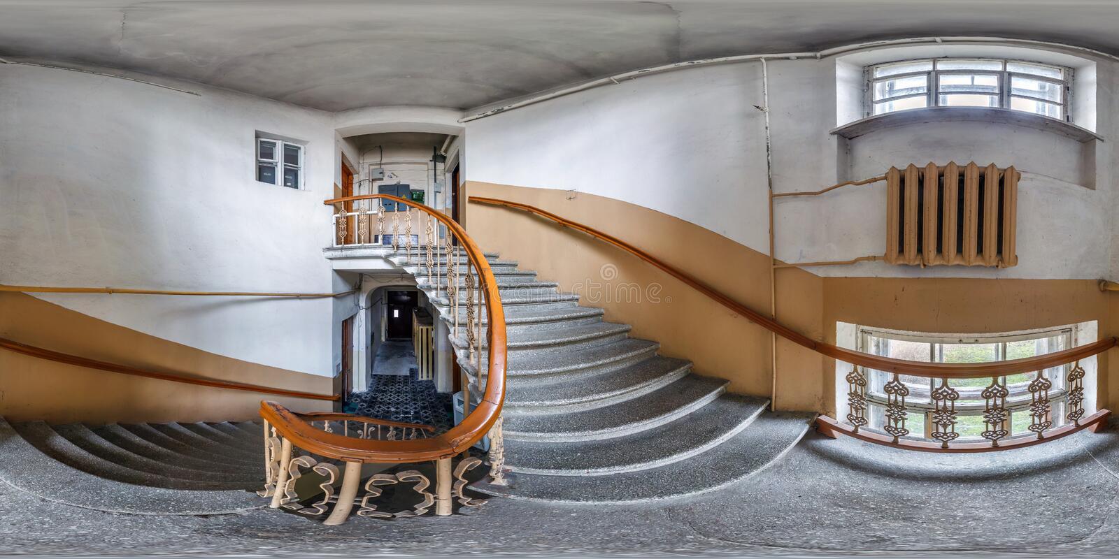 Full seamless spherical hdri panorama 360 degrees angle view in interior of empty corridor in entrance with old spiral staircase stock images